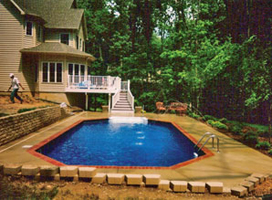 Nice inground Pool example with multi story house behind it