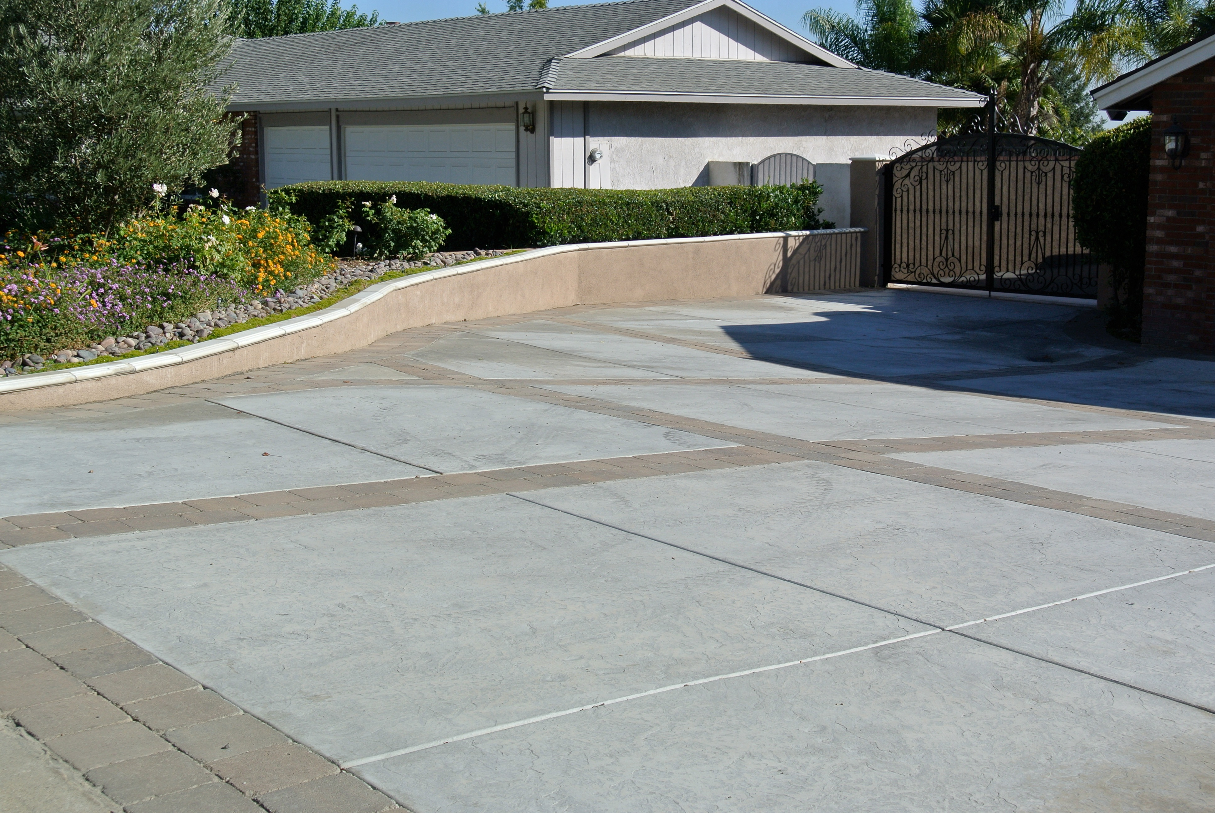 Concrete Driveway Example With Wrought Iron Gate And