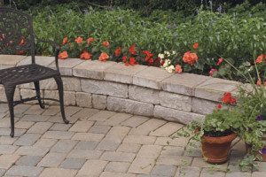 Retaining wall with garden full of colorful flowers and a table in Northern VA