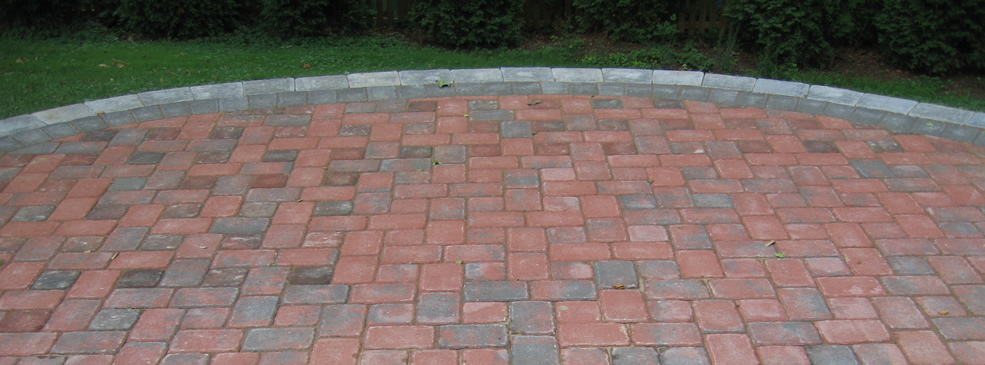 Example of a brick patio in Northern Virginia