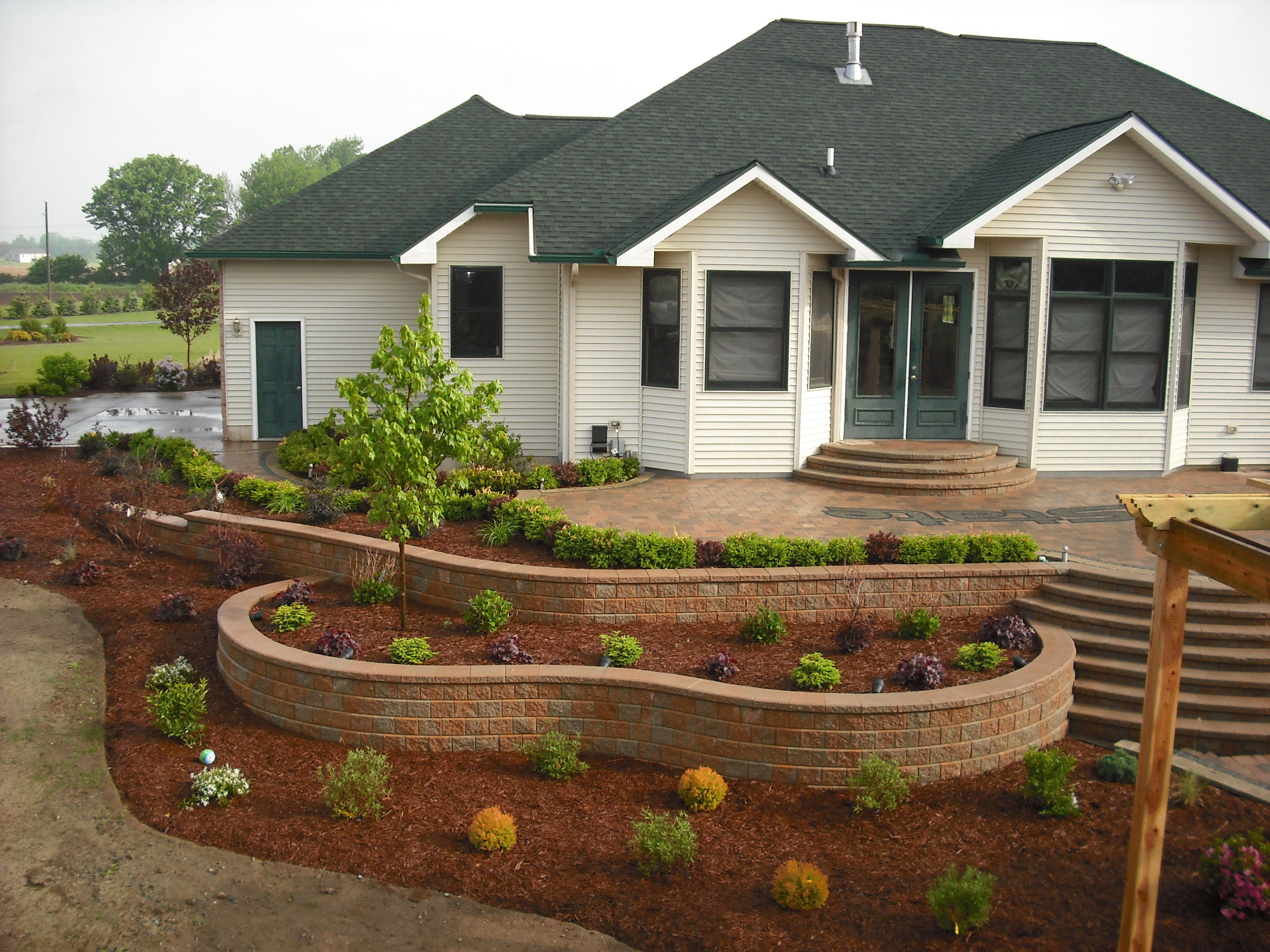 Landscaping wall construction company north va md dc for Designs for brick garden walls