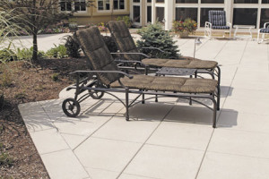 Example of a stone patio pool deck with chairs in northern VA