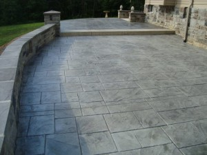 Example of a stamped concrete area next to a big house