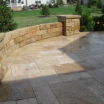 Retaining wall on top of flagstone