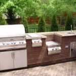 Stainless Steel and Brick Outdoor Kitchen, Grill and Bar