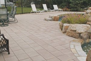 Nice stone patio with pond and chairs