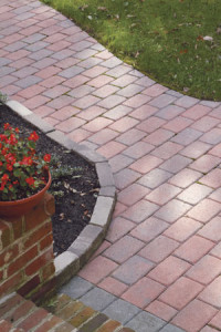 Example of a red brick patio with a garden surrounding it