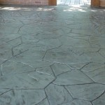 Brick walls on top of stamped concrete