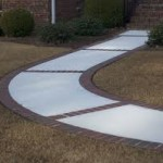 Custom Concrete and Brick Walkway to Home Entrance