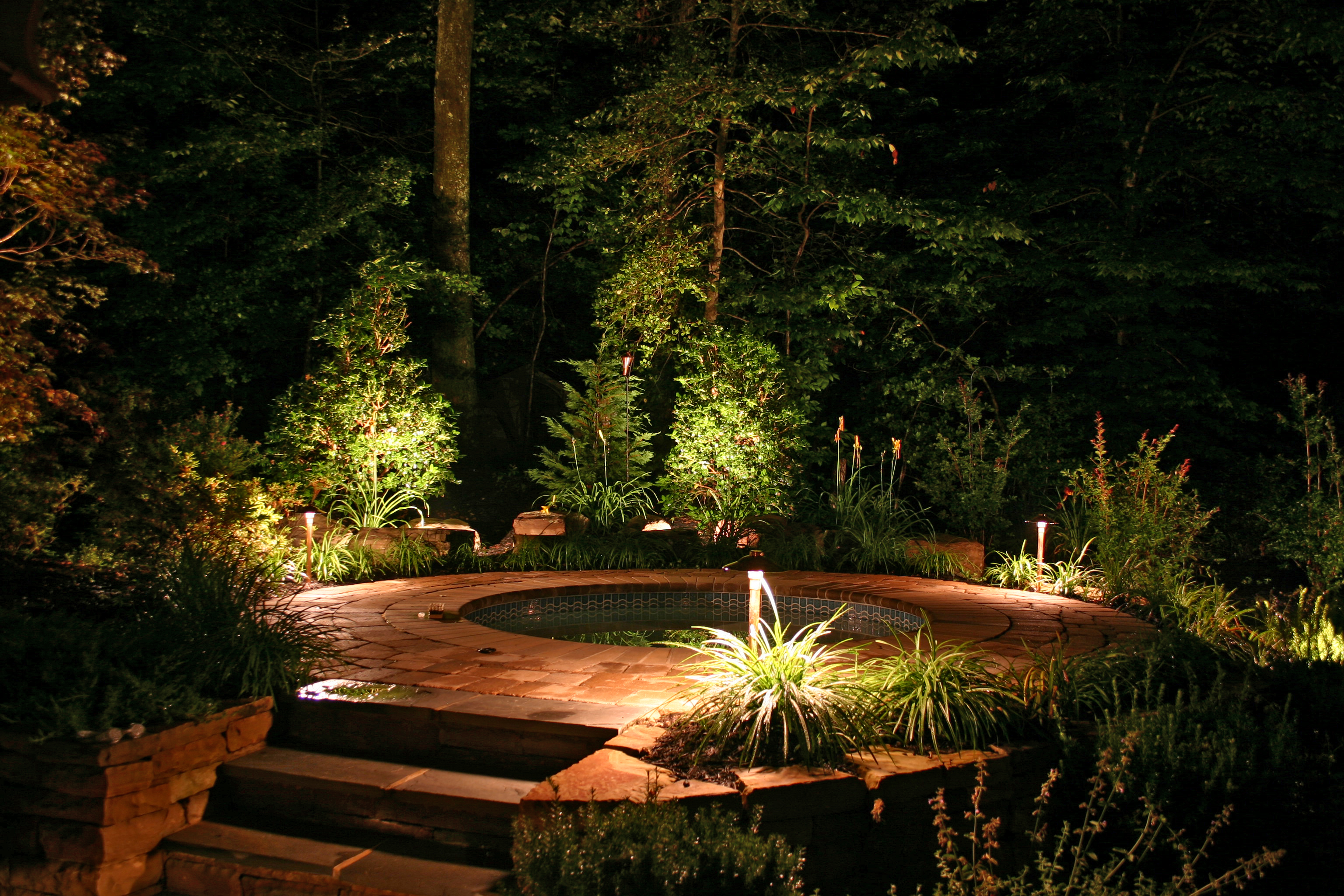 Pool And Jacuzzi Steps Propery Lit By Outdoor Lighting