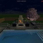 Focus on the night time lounge area with fire