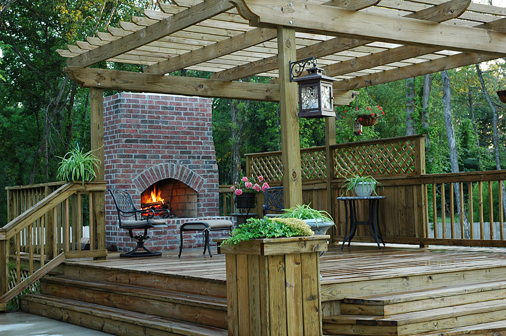Custom wood deck outdoors fireplace for Hardwood outdoor decking